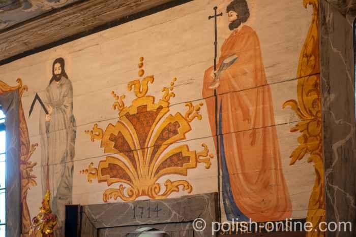 Aposteln über der Tür zur Vorhall der Pfarrkirche in Reichenau (Rychnowo) in Masuren