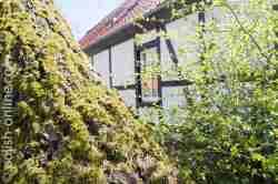 Foto von einem Fachwerkhaus am Eingang des Slowinzischen Nationalparks